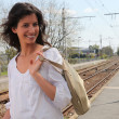 Stock Photo: Young woman waiting for the train on the platform