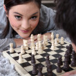 Young couple playing chess — Stock Photo #8536592