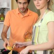 Couple cooking pasta — Stock Photo