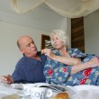 Older couple having breakfast in bed — Stock Photo