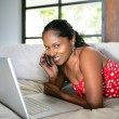 Afro-American woman relaxing on the couch - Stock fotografie