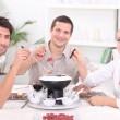 Friends eating together — Stock Photo