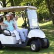 Couple in golf buggy — Stock Photo #8538284