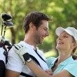 Couple embracing on the golf course — Stock Photo