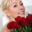 Woman with a bunch of red roses — Stock Photo