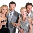 Double date: couples in party dress drinking champagne — Foto Stock