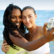 Girls taking a picture while on holiday — Stock Photo