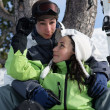 Teenage couple on a ski holiday — Stock Photo