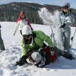 Friends having fun in snow — Stockfoto