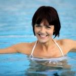 Beautiful woman in swimming pool — Stock Photo