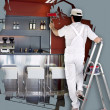 House painter on ladder using roller — Stock Photo