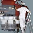 House painter on ladder using roller — Stock Photo
