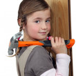 Girl with hammer — Stock Photo