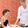 Stock Photo: Waitress serving meal