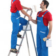 Stock Photo: Decorators shaking hands