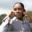 Businesswoman making a call as she is lost — Stock Photo #8539319