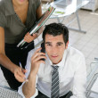 Businessman and his assistant in the office — Stock Photo