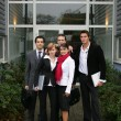 Young team outside an office building — Stock Photo