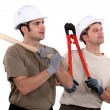 Stock Photo: Two manual workers stood together
