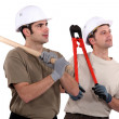 Two manual workers stood together — Stock Photo