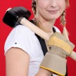Woman carrying a mallet on her shoulder - Stock fotografie