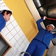 Workers working on air conditioning — Stockfoto