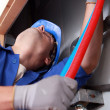 Plumber installing plastic domestic water pipes — Stock Photo #8539736