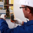 An electrician checking the energy meter. — Stock Photo #8539756