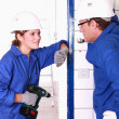 Electricians chatting on the job — Stock Photo #8539764