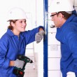 Stock Photo: Electricians chatting on the job