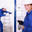 Female electrician with a power drill — Stock Photo