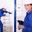 Female electrician with a power drill — Stock Photo #8539773