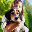 Child holding dog — Foto de stock #8539880