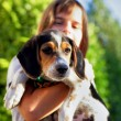 Child holding dog — Stock Photo #8539880