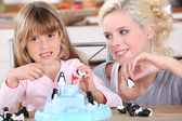 Woman and little girl playing with toys — Stock Photo