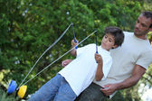 Son playing with diabolo — Stock Photo