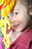 Portrait of mischievous little girl posing with toy — Stock Photo