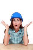 Surprised female construction worker — Stock Photo