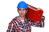 Worker carrying a toolbox — Stock Photo