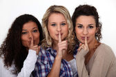 Three women making shush gesture — Stock Photo