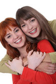 Portrait of smiling sisters — Stock Photo
