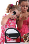 Little girls playing with mummy's makeup and jewelry — Stock Photo