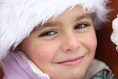 Portrait of a cute little girl by wintertime — Stock Photo