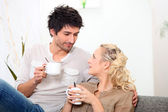 Couple having a cup of coffee together in the morning — Stock Photo