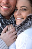 Couple huddling in the cold — Stock Photo