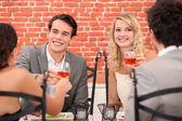 Friends enjoying a meal together — Stock Photo