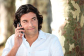 Man making call in park — Stock Photo
