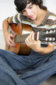 Teen with classical guitar — Stock Photo