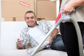Man on a couch — Stock Photo
