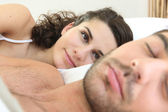 Woman looking at her husband sleeping — Stock Photo